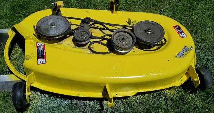 Repainted lawn mower deck with spraypaint