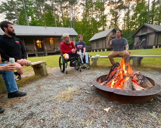The BuyWake crew and Wake for Warriors participants gathered around the bonfire at Pine Acres Retreat