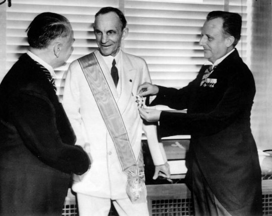 Henry Ford receiving the Grand Cross of the German Eagle from Nazi officials, 1938