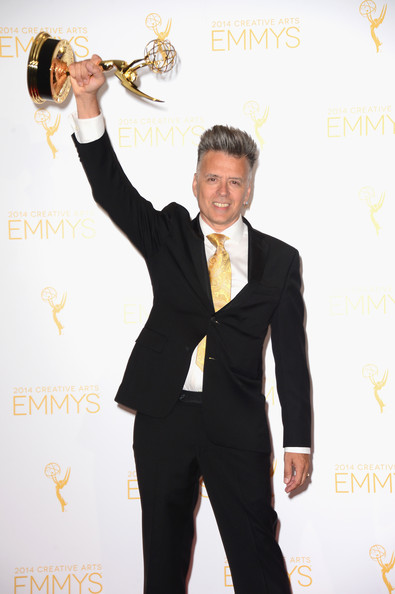 Designer Valerio Ventura celebrates his win at the 2014 Creative Arts Primetime Emmy Awards
