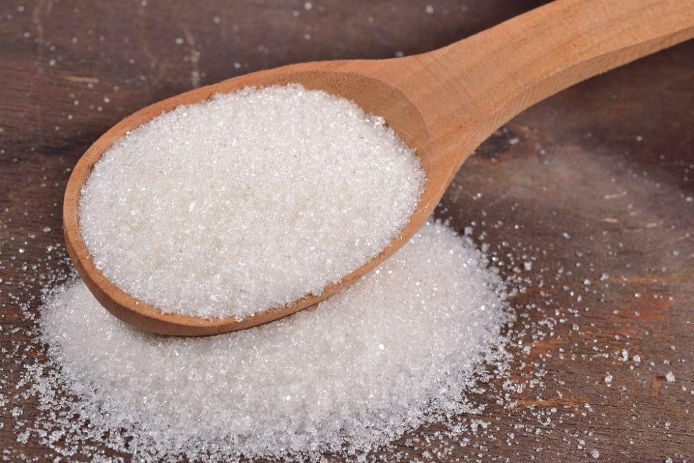 White Sugar In A Spoon