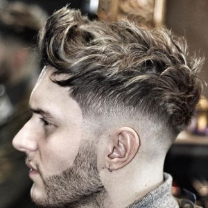 Low Skin Fade Hairstyle with Long Wavy Hair