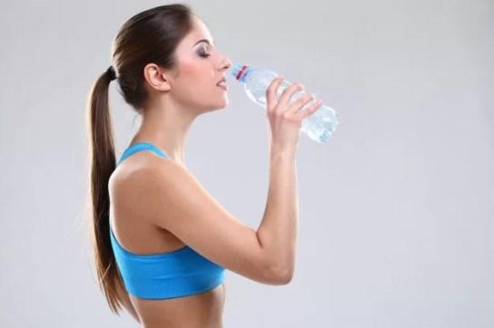 beautiful-Caucasian-woman-fitwear-drinking-water-hydrating-her-body