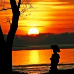Sunset near boy fishing statue