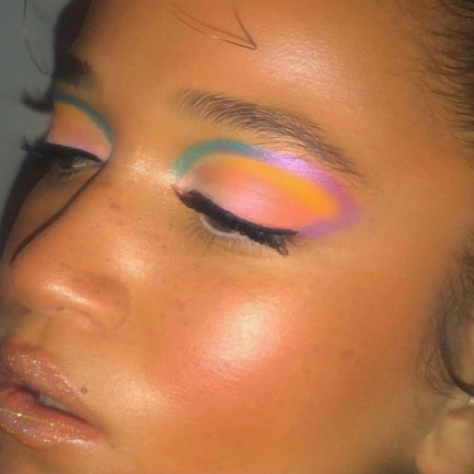 Multicolor eye looks is one of this years biggest eyeshadow trends. This is a multicolor eyeshow look with bright summer colors like purple, yellow, pink, and turquoise.