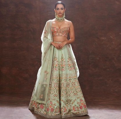 Mint green lehenga skirt with baby pink heavily embroidered blouse. Perfect for spring and summer weddings.