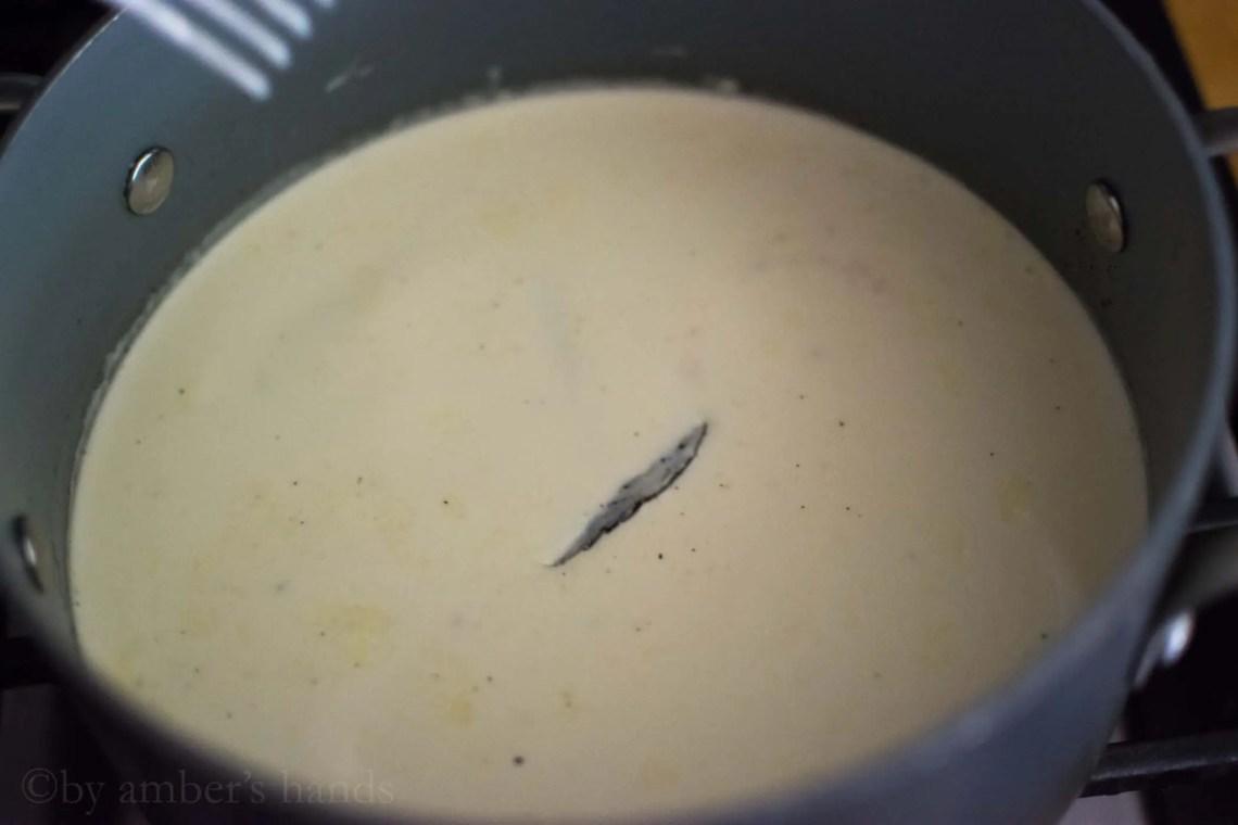 simmering vanilla bean in cream