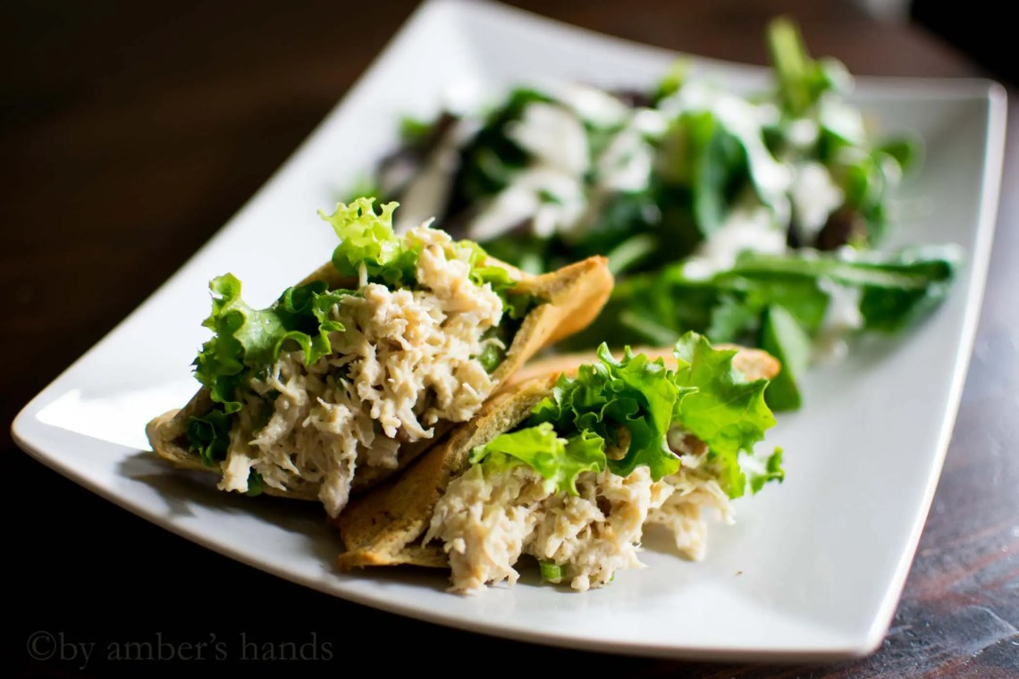 Pitas stuffed with shredded chicken salad