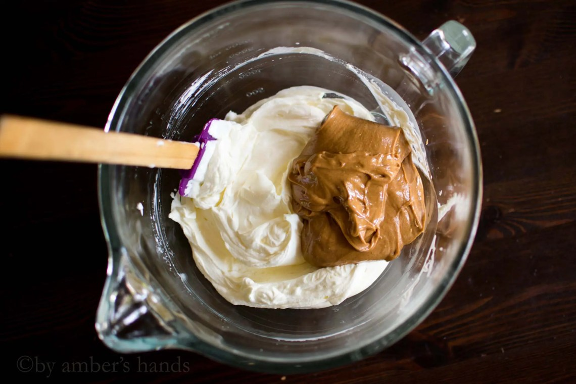 Whipped cream, cream cheese, and peanut butter in mixing bowl