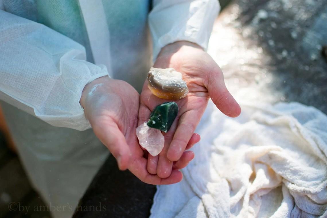 child holding gem stones