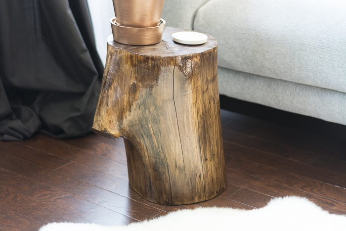 learn how to make a tree stump side table by staining and finishing a stump