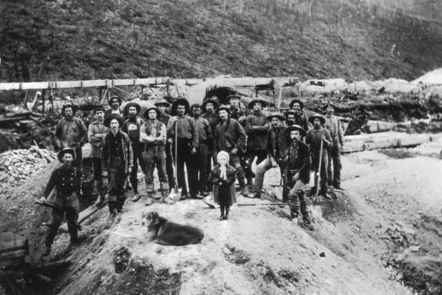 Gold miners working on W.M. Cowley's claim, 22 Above, Bonanza, Klondike. Alaska, 1897.