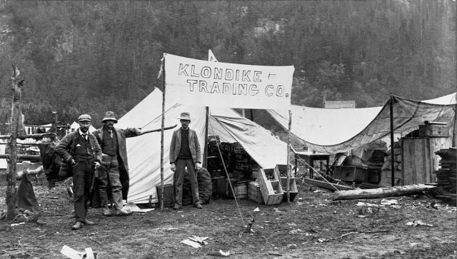The Klondike Trading Company, a general store in a tent, during the Klondike Gold Rush. Alaska, 1897.