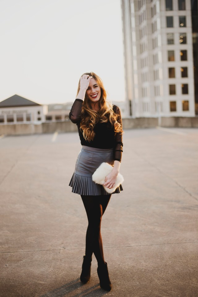 A faux leather mini skirt with tights and booties in downtown Austin, TX | By Hilary Rose Blog
