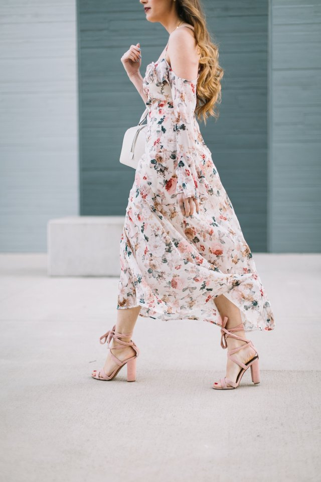 By Hilary Rose Austin blogger wearing a spring floral maxi dress and Henri Bendel bag and blush lace up heels