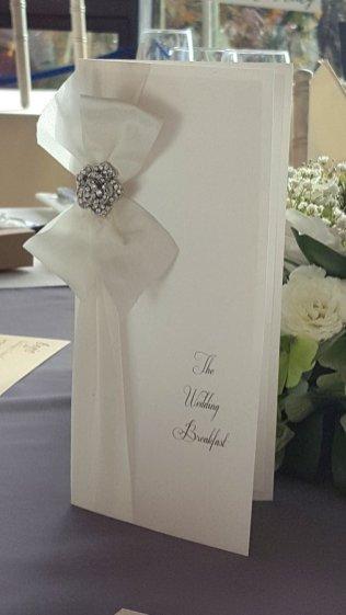 White ribbon & crystal flower menu