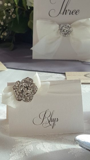 White ribbon & crystal flower place card