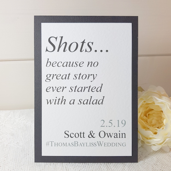 black and white shots wedding sign