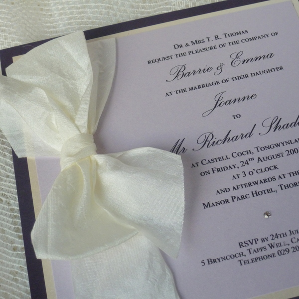 purple and lilac wedding invitation with silk bow