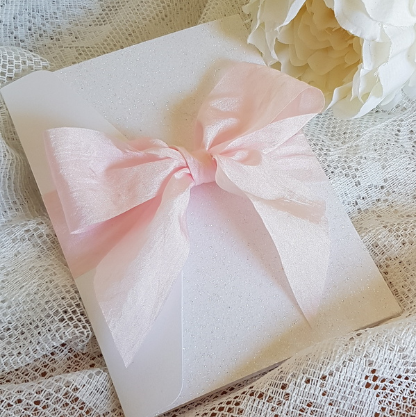 pocketfold invitation with pink silk bow and white glitter