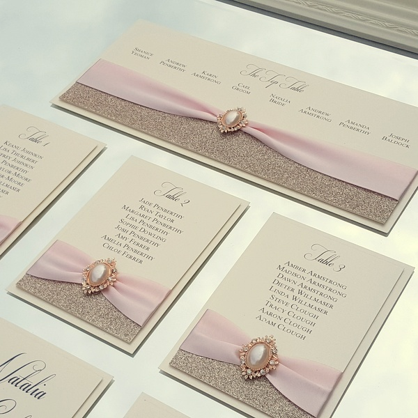 wedding table plan with champagne glitter and rose gold pearl embellishments