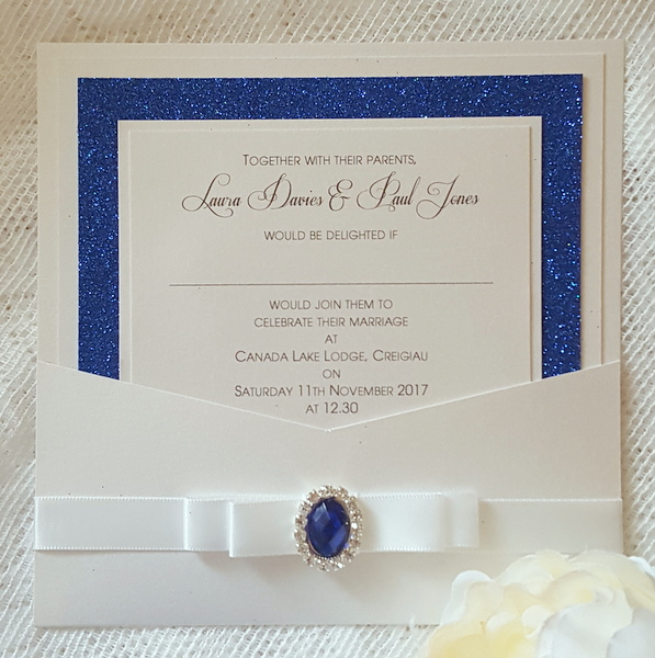 wallet wedding invitation with royal blue glitter and diamante gem