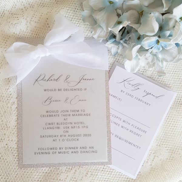 vellum and glitter invitation with white silk ribbon
