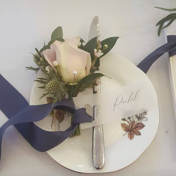 vellum place tag with navy silk ribbon