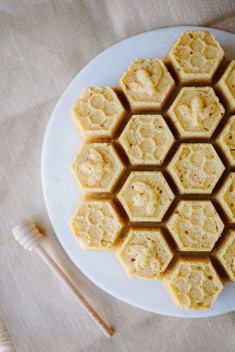 honey lemon loaf cake in bee hive shape on round marble tray