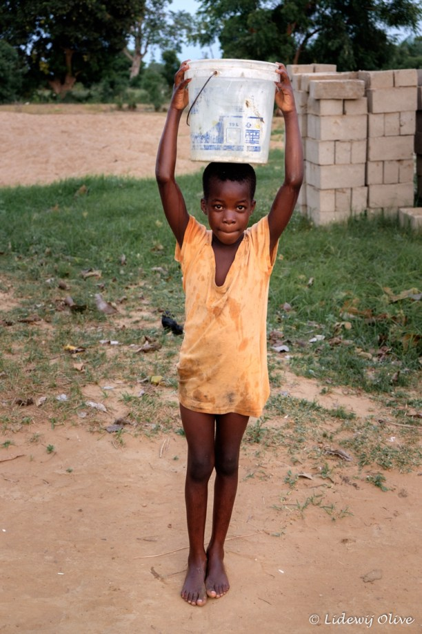 kid carrying water