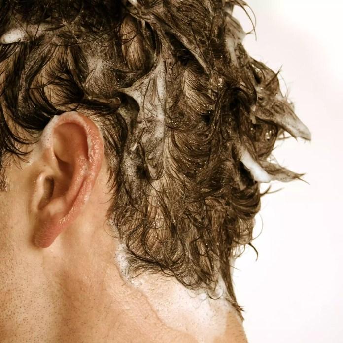 shampoo on a man's hair
