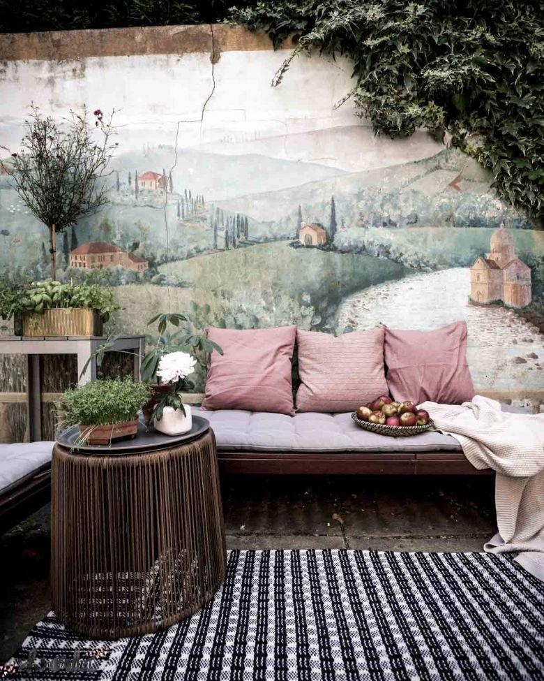 little garden nook with wall mural