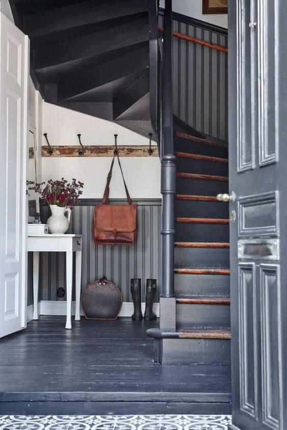 grey hallway with rustic stairs