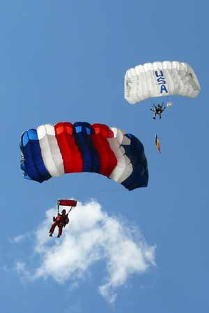 sky diving picture in Orange by Mike Phillips