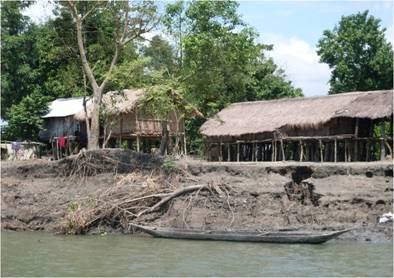 A Mising (ethnic tribe) village at  upper Assam's Lakhimpur district with houses built on stilts to escape the wrath of floods