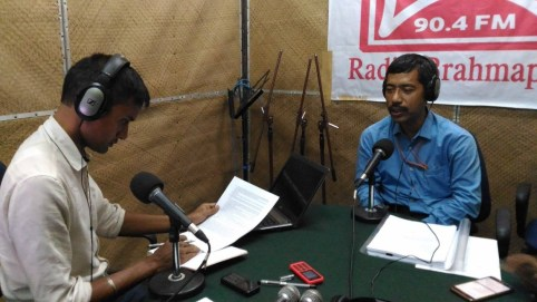 "Ranjit Borgohain, Senior Area Manager, Indane Area Office Indian Oil-AOD, answering questions of radio Brahmaputra listeners during a live show ""PRASANGIK"" conducted by Bhaskar Bhuyan,(left) the coordinator of the station on Pradhan Mantri Ujjwala Yojana-LPG connection for BPL category women, on 24th Oct, 2016 at Radio Brahmaputra Studio"