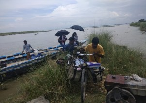 The health team accompanied by the Pratyasha Achrya on way to Kaltuli char(left) and with the Kamrup boat clinic team