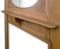Tall 1920s fireplace mantel in Oak with oval mirror