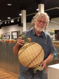 stephen kostyshyn holding a vase. reed basketry