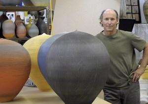 Nicholas Bernard next to his large ceramic vessels