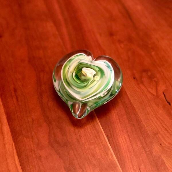 handblown glass heart on a table