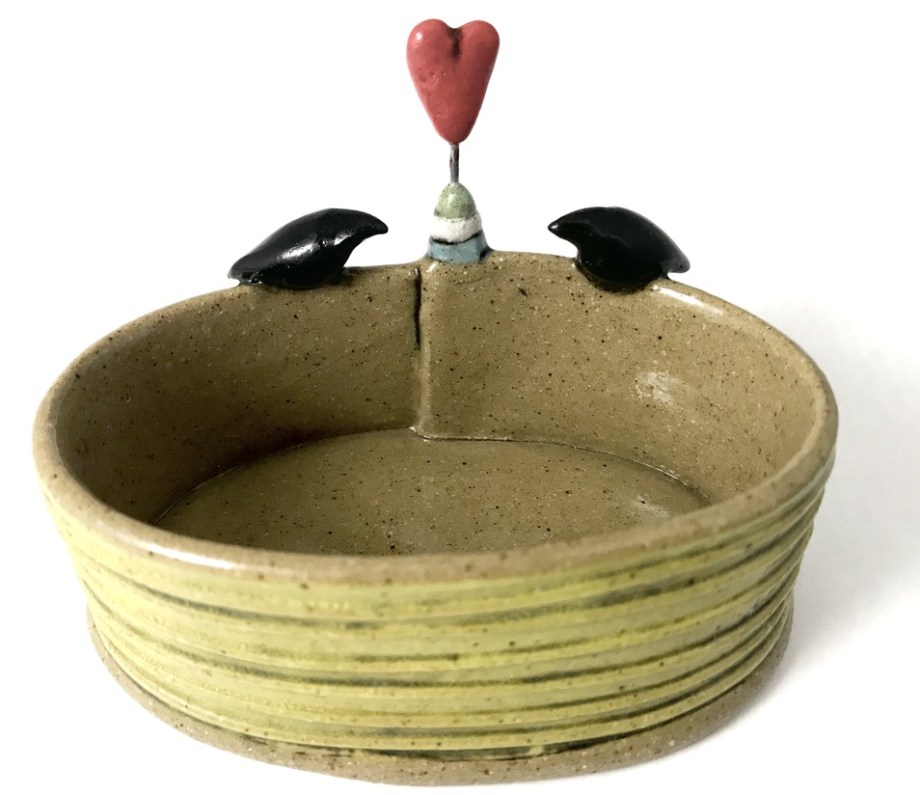 handmade ceramic green tray with raven and heart