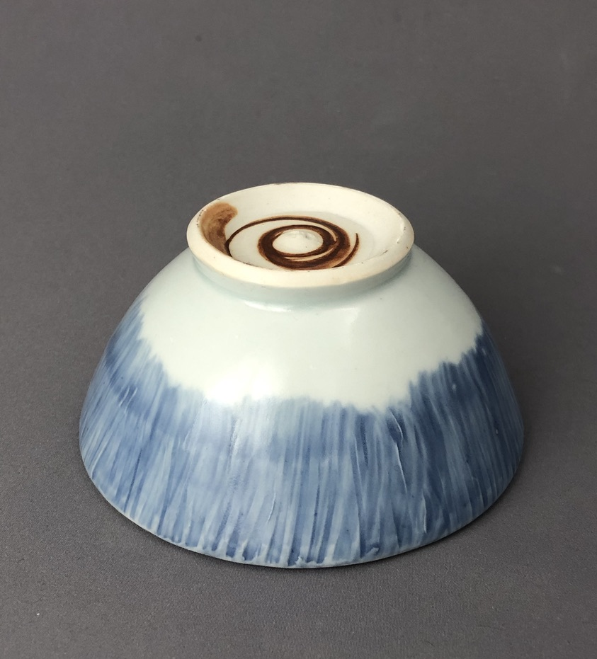 bottom of small blue ceramic bowl