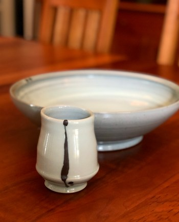 tall porcelain cup next to platter by Julie Devers