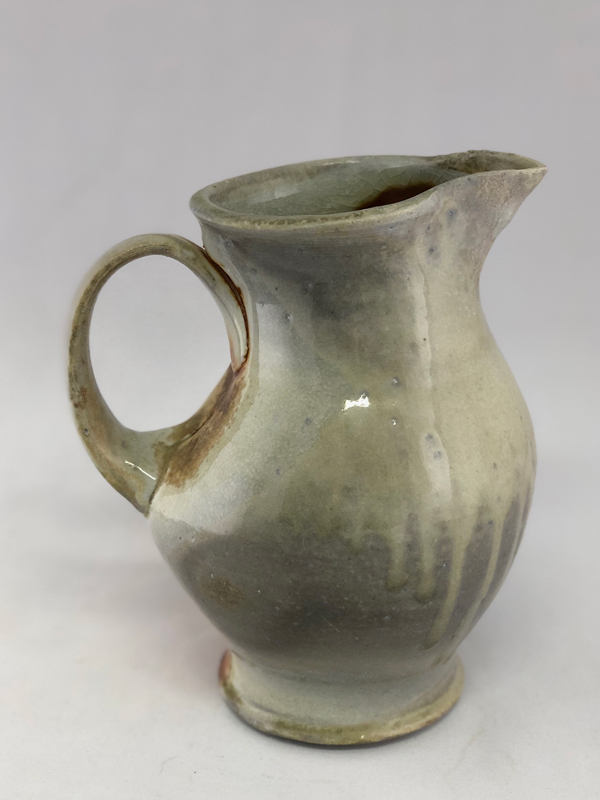 side 1 view of wood fired mini pitcher by Julie Devers
