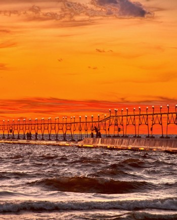 photograph of the grand haven pier at sunset in the fall