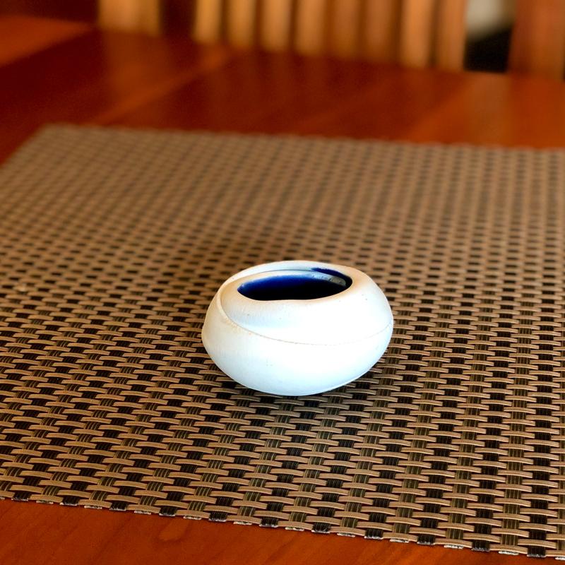 Dark Blue Interior Salt Nest sitting on a table