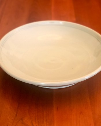 large handmade ceramic serving bowl on a table