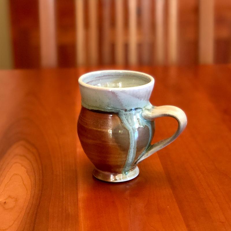 handmade wood fired mug sitting on a table
