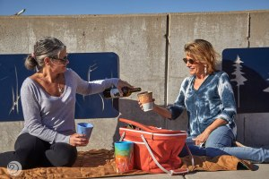 Cyndi and Sarah enjoying a picnic with handmade pottery